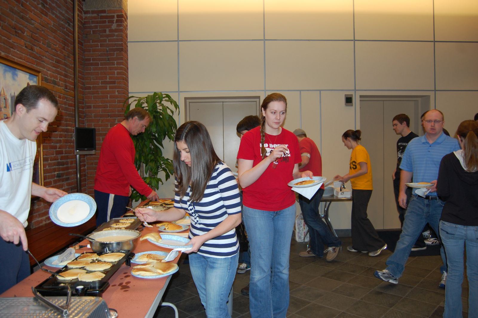 Schneider Downs employees help themselves to our annual Pancake Breakfast during tax season.